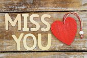"picture of miss you  - ""Miss you"" written with wooden letters next to red wooden heart - JPG"