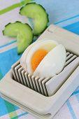 Hard boiled egg in egg slicer, closeup