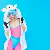 Teddy Bear Girl On A Blue Background. Crazy Winter Party. Club Dance Style