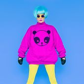 Fashion Lady Loves Panda. Funny Photo. Girl In A Bright Wig On A Blue Background. Japanese Style