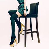 image of stocking-foot  - Fashion sexy lady in stockings and high heels sitting on bar stool - JPG