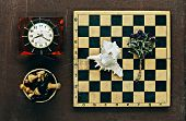 Chess, Clock And Seashell On Old Wooden Background