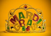 stock photo of crown jewels  - A jeweled Mardi Gras crown on a yello backgroung - JPG
