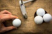 Holding Golf Balls