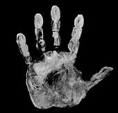 white hand print isolated on black background