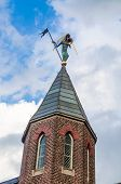Church Spire With Figure