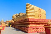 foto of recliner  - Image of Reclining Golden Buddha in the centre of Vientiane Laos.