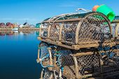 Old style lobster traps on a wharf if rural Prince Edward Island, Canada.