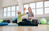 Senior Woman Rejoicing Health Success With Her Instructor