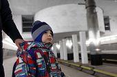 Mother Holding Son On Subway Platform
