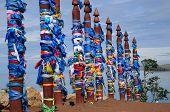 A vertical wooden ritualistic pillars serge. 10.07.2014. Russia. Irkutsk region. Olkhon Island. Baik
