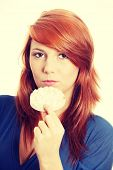 Young and beautiful woman with rice cake wafers