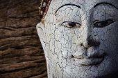 Close-up Of A Wood Buddha Sculpture