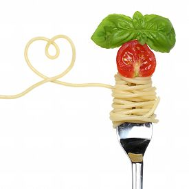 picture of noodles  - Spaghetti noodles pasta meal with heart tomato on a fork love topic - JPG