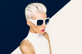 foto of gothic hair  - Blonde model in trendy sunglasses with stylish Haircut - JPG