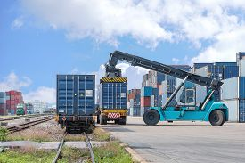 pic of forklift  - forklift handling container box loading to freight train - JPG