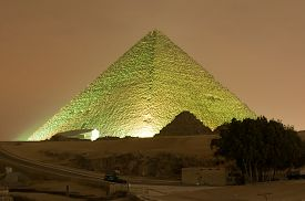 foto of triangular pyramids  - CAIRO EGYPT - JANUARY 1 2009: Giza pyramid and Sphinx light up for magical sound and light show. ** Note: Visible grain at 100%, best at smaller sizes - JPG