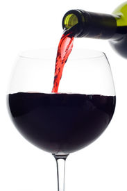 foto of red wine  - Red wine pouring down from a wine bottle  - JPG