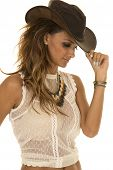 picture of cowgirl  - a cowgirl in her western hat pulling down the brim - JPG