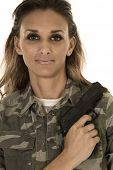 picture of camo  - A woman in her camo with her pistol on her shoulder she has a small smile on her lips - JPG