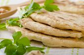 foto of chickpea  - Lebanese bread pita bread nice and fresh chickpeas in background simple cheap bread with herbs and garlic - JPG