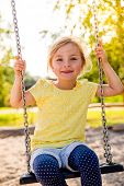 foto of swing  - brighter day child swinging high - JPG