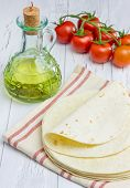 image of whole-wheat  - Whole wheat flour tortillas with tomatoes and olive oil on the background - JPG