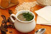 picture of porridge  - dried mushrooms and porridge soup in a porcelain pot - JPG