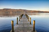 stock photo of calming  - Perspective view of a wooden jetty on Windermere in the English Lake District - JPG