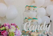 image of wedding feast  - Cute candy bar with various candies and cakes