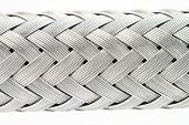 picture of reinforcing  - macro image of a metal wire braided reinforced hose - JPG