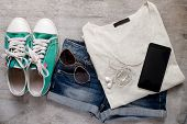 pic of outfits  - Overhead of essentials of a modern woman - JPG