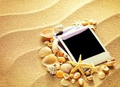 image of beach shell art  - Summer like old style empty photo cards lying on a sea sand and framed with shells - JPG