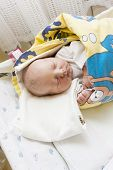 stock photo of maternity  - portrait of a newborn baby girl in maternal hospital - JPG