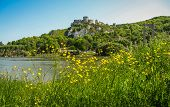 picture of yellow castle  - Scenic ruins of an ancient castle on the river shore Les Andeles France - JPG