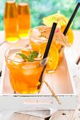 image of refreshing  - Refreshing lemonade with oranges and mint on wooden table - JPG