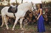 stock photo of horse girl  - Beautiful girl with horse and long hair - JPG