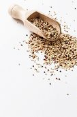 image of quinoa  - quinoa seed grain in a wooden bowl scoop  - JPG