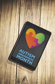 stock photo of aspergers  - autism awareness month against overhead of tablet on desk - JPG