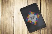 picture of autism  - Autism awareness month against overhead of tablet on desk - JPG