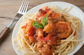 picture of shrimp  - shrimp cooked in wine tomato sauce with fresh basil over spaghetti pasta - JPG