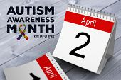 picture of autism  - autism awareness month against bleached wooden planks background - JPG