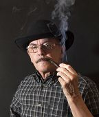 stock photo of hillbilly  - Cowboy in hat with Pipe  - JPG