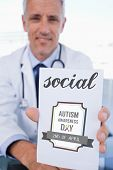 picture of prescription pad  - The word social and portrait of a male doctor showing a blank prescription sheet against autism awareness day - JPG
