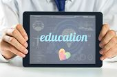 stock photo of autism  - The word education and autism awareness heart against medical biology interface in blue - JPG