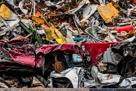 image of scrap-iron  - old cars were scrapped in a trash compactor - JPG