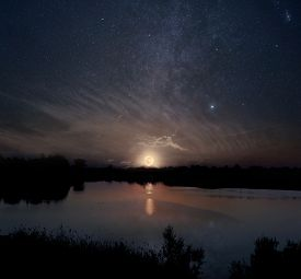 foto of moon silhouette  - Night sky with rising full moon over the lake - JPG