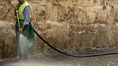 stock photo of cleaning service  - man cleaning the street - JPG