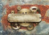 Clockwork mechanism on rusty background made of metal gears and brass plate. poster
