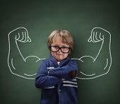 Strong man child showing bicep muscles concept for strength, confidence or defense from bullying poster